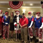 Christina, the Community Life Director and volunteer WWII Bomber Girl, poses with the Santa Claus Drill Team and Guest Speaker, Scott Hood! A Big thank you to everyone!