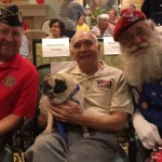 Our wonderful guest speaker, Scott, and one of the members from Santa's Drill Team pose with George, one of the community's recent Honor Flight participants!
