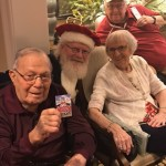 Pat, Evelyn, and Chuck all share a great moment with Santa!