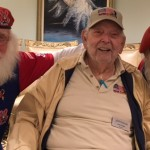 Jerry and 2 smiling Santas enjoying a great moment together!