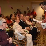 Elvis was leading the couples in reciting their vows (again).