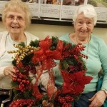 Virginia and Anna holding up their wreath project!