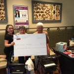 Michelina thanking Carol and Mae for their support and helping her carry that giant check!