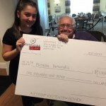 Chuck and Michelina showing off that giant check!