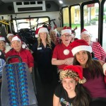 Group photo on the bus as we make our way down to deliver the toys!