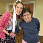 Community Life Director, Christina posing with Marie showing off their funky style!