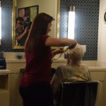 Jean getting her hair done by one of our wonderful volunteers, Lisa.