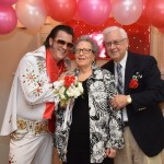 Phyllis and Joseph posing with Elvis!