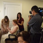Regina getting pampered and video taped by Fox 13's Barry Wong.