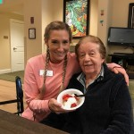 Community Life Assistant, Shelbey, and Gigi are staying warm inside while enjoying these cool berries!