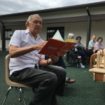 George reading Green Eggs and Ham to the students.