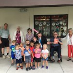 More VPK kids posing with residents from The Watermark at Trinity!