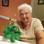 Mae is showing off her beautiful tissue paper shamrock!