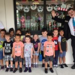 George and The Cat in the Hat posing with one of the VPK Classes!