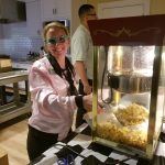Pink lady serving up fresh movie theater popcorn