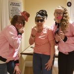 Resident and staff posing for silly photo opp
